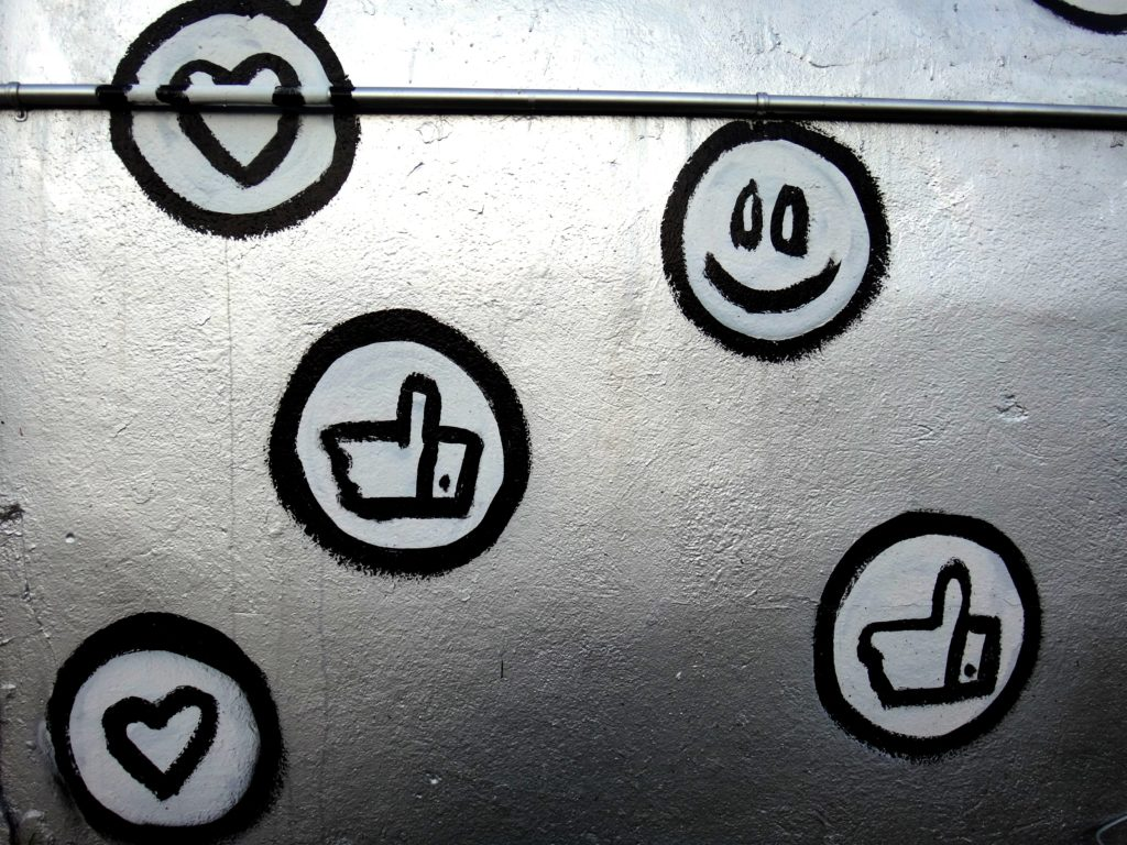 "Emoticons and ""like"" buttons"