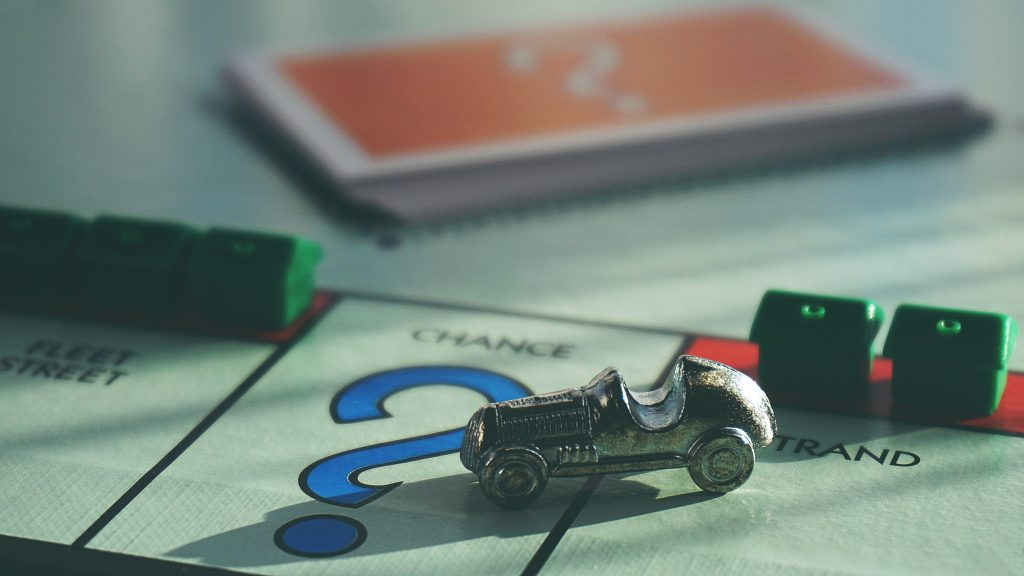 Figure car on Monopoly game board