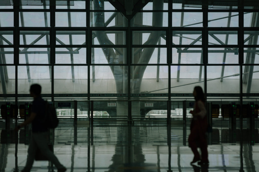 Passengers walking through an airport