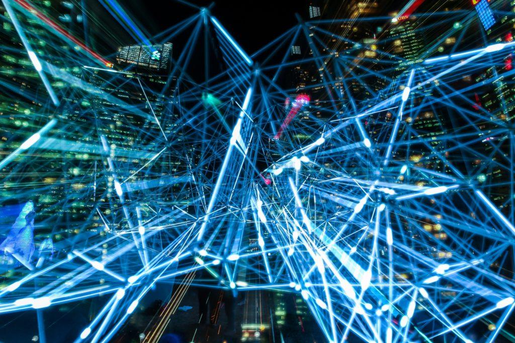 Blue network of lights against dark background