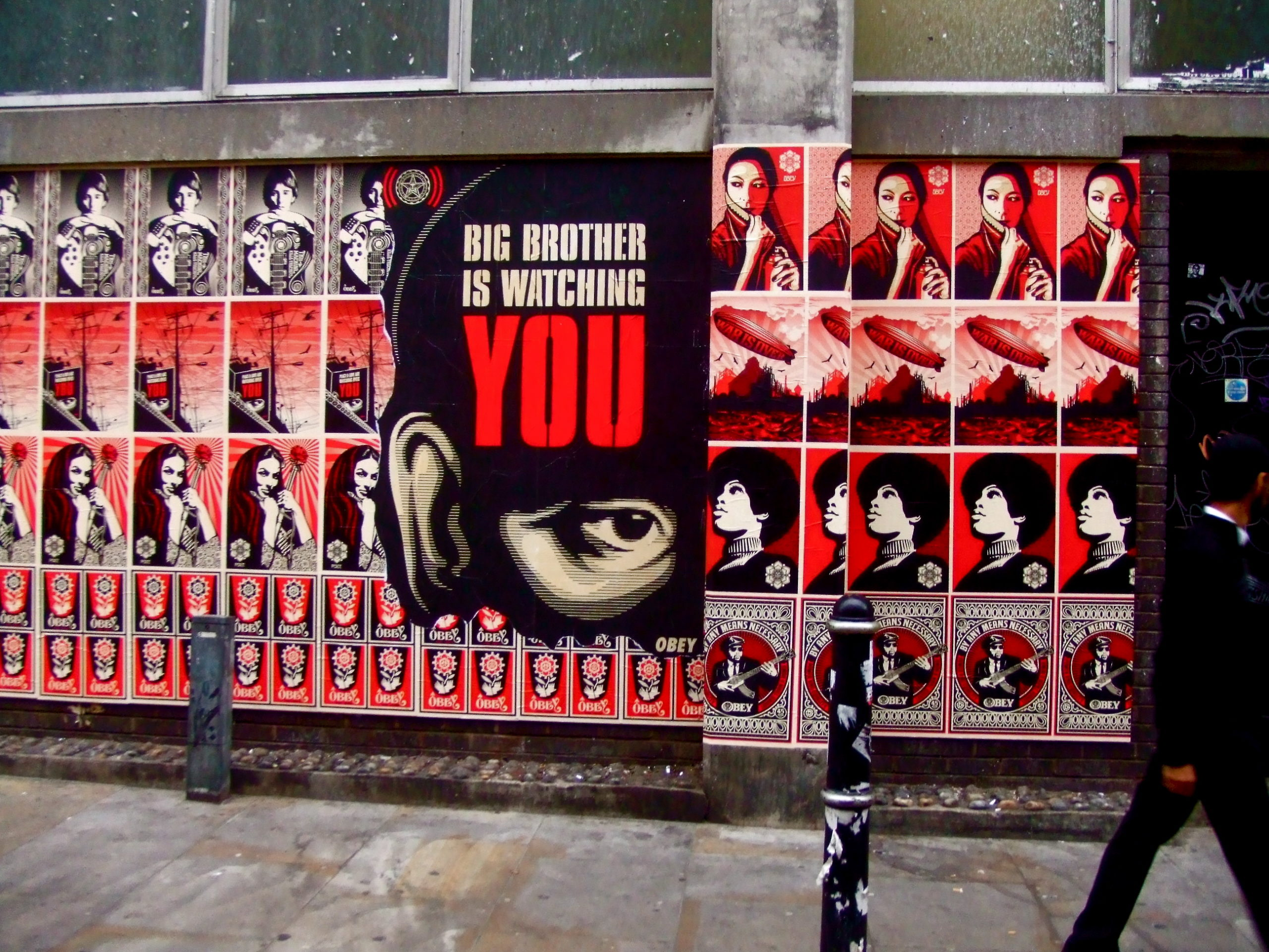 """Posters on a street, including a large poster saying """"Big Brother is watching you"""". Photo by Shepard Fairey in London: Big Brother Is Watching YOU CC BY-NC-ND 2.0"""