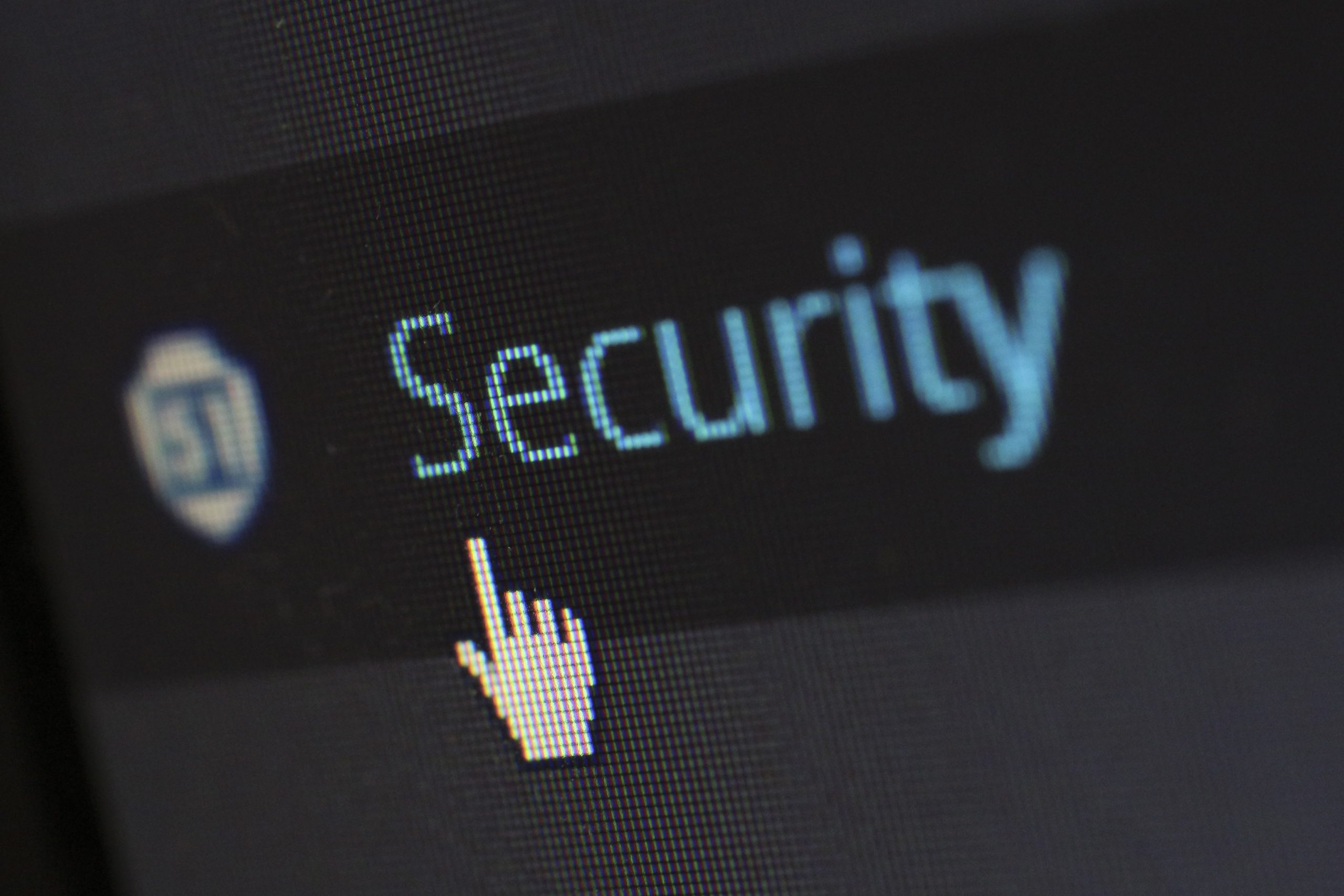 """Zoomed in cursor hovering over the word """"Security"""". Photo by Pixabay from Pexels"""
