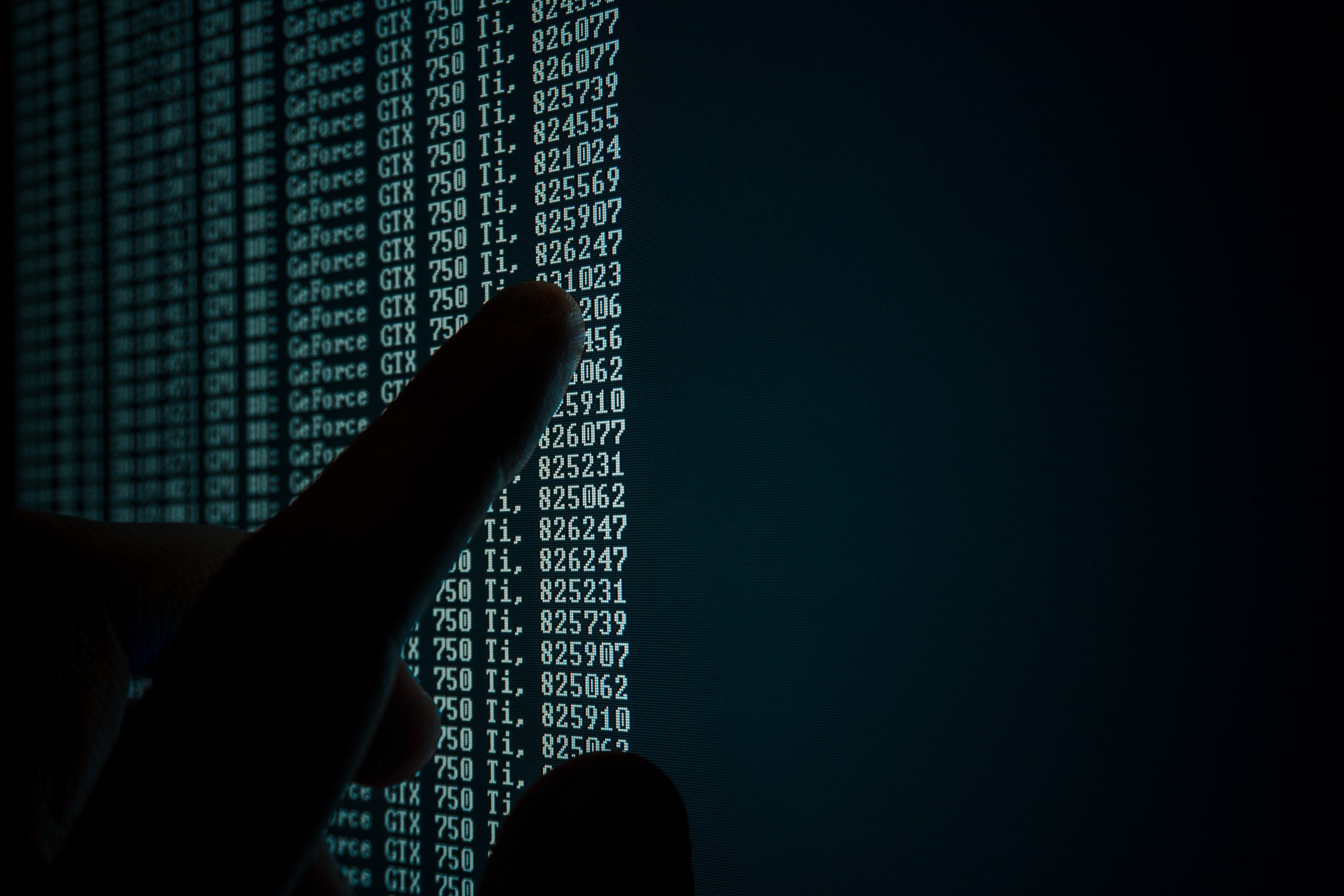 A hand pointing to rows of data Credit: Vitaly Vlasov from Pexels